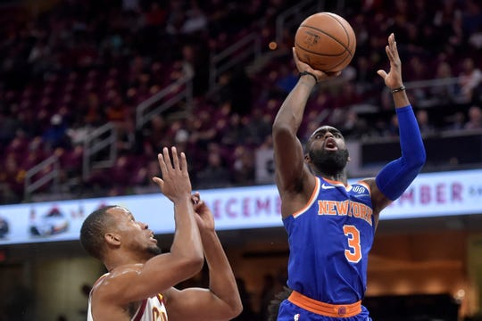 Dec 12, 2018; Cleveland, OH, USA; New York Knicks guard Tim Hardaway Jr. (3) shoots beside Cleveland Cavaliers guard Rodney Hood (1) in the first quarter at Quicken Loans Arena.