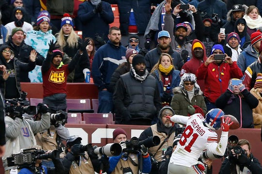 Dec 9, 2018; Landover, MD, USA; New York Giants wide receiver Russell Shepard (81) celebrates by throwing the ball into the stands after scoring a touchdown against the Washington Redskins in the third quarter at FedEx Field. The Giants won 40-16.