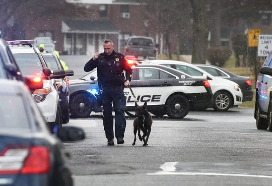 A K9 officer arrives at the scene where a bomb threat takes place at the building of Maywod Furniture De Saussure Equipment Co., in Maywood on 12/13/18.