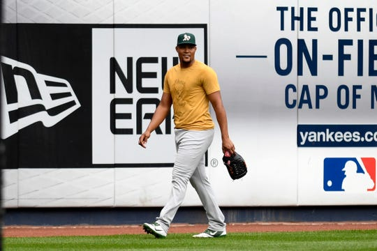Oakland A's pitcher, and former Met, Jeurys Familia walks onto the field at Yankee Stadium for a team workout. The New York Yankees and Oakland A's work out ahead of the wildcard game at Yankee Stadium on Tuesday, October 2, 2018.