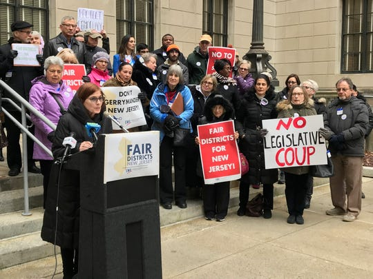 Marcia Marley, president of BlueWaveNJ, a progressive grassroots organization, spoke in opposition to a controversial redistricting proposal during a news conference on the steps of the Statehouse on Dec. 13, 2018.