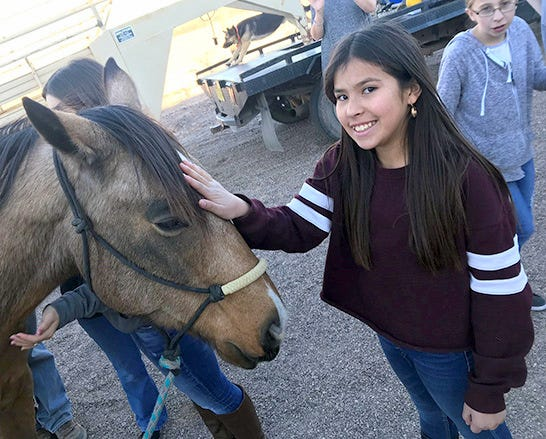 Jakelin Ramirez (center) and Brooke Cruse (right) learned about animal science careers from Jill Black, owner of Walking Sixes Equine and Canine Massage Therapy.The two Red Mountain Middle School students are members of the Dream Makers Club. The Dream Makers got up close and personal with Chance, a retired quarter horse. The Forward New Mexico sponsored Dream Makers Club gives middle school students an opportunity to experience the diverse careers available in health sciences.