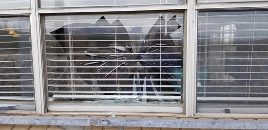 A mother and daughter came home to a broken window and feces on their back porch Tuesday.