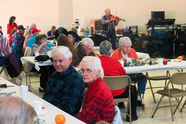 In this 2014 file photo, Tularosa residents enjoy a Christmas Day meal while listening to music.