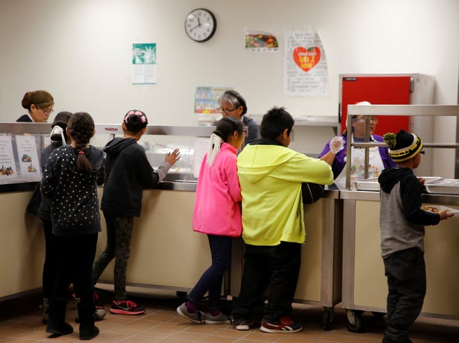 The lunch menu on Wednesday at Eva B. Stokely Elementary School in Shiprock included whole grain chicken corn dogs, baked fries and cups of grapes, carrots and broccoli.