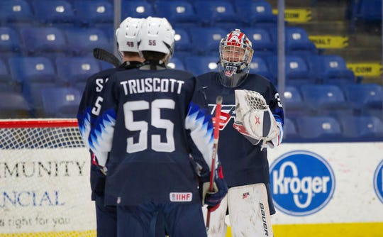 Following Wednesday's 3-1 win over Team Switzerland at USA Hockey Arena in Plymouth, winning goal scorer and Michigan native Jacob Truscott (55) gets ready to exchange high fives with goalie Drew Commesso.