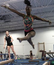 Sophomore captain Kalyn Mullens wants to start a 'new foundation for gymnastics' in Bloomfield Hills.