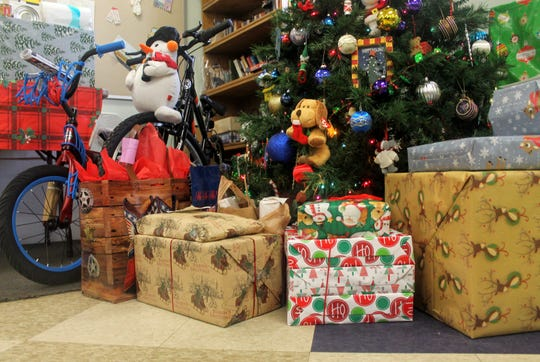 Several presents under the tree at the bus building on Raphael in Farmington. The gifts were scheduled to be delivered to the school Dec. 14.