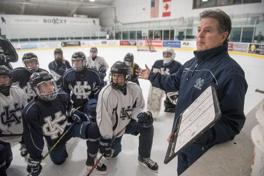 Cranbrook Coach Andy Weidenbach speaks with the team during Wednesday afternoon practice.