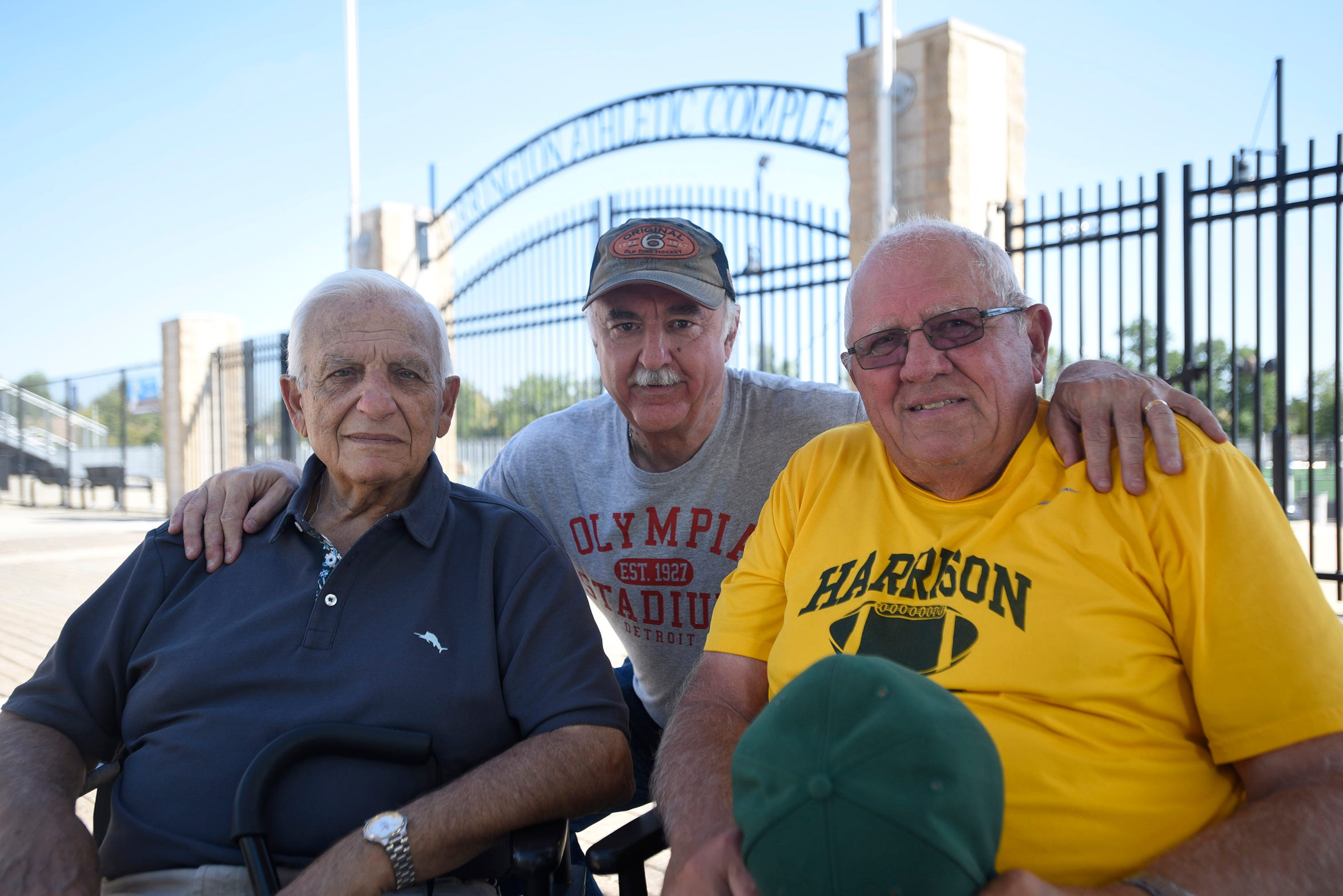Hometown Life sports editor Marty Budner poses with high school football legends Al Fracassa (left) and John Herrington.