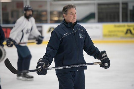 Cranbrook Hockey Coach Andy Weidenbach keeps an eye on team practice.