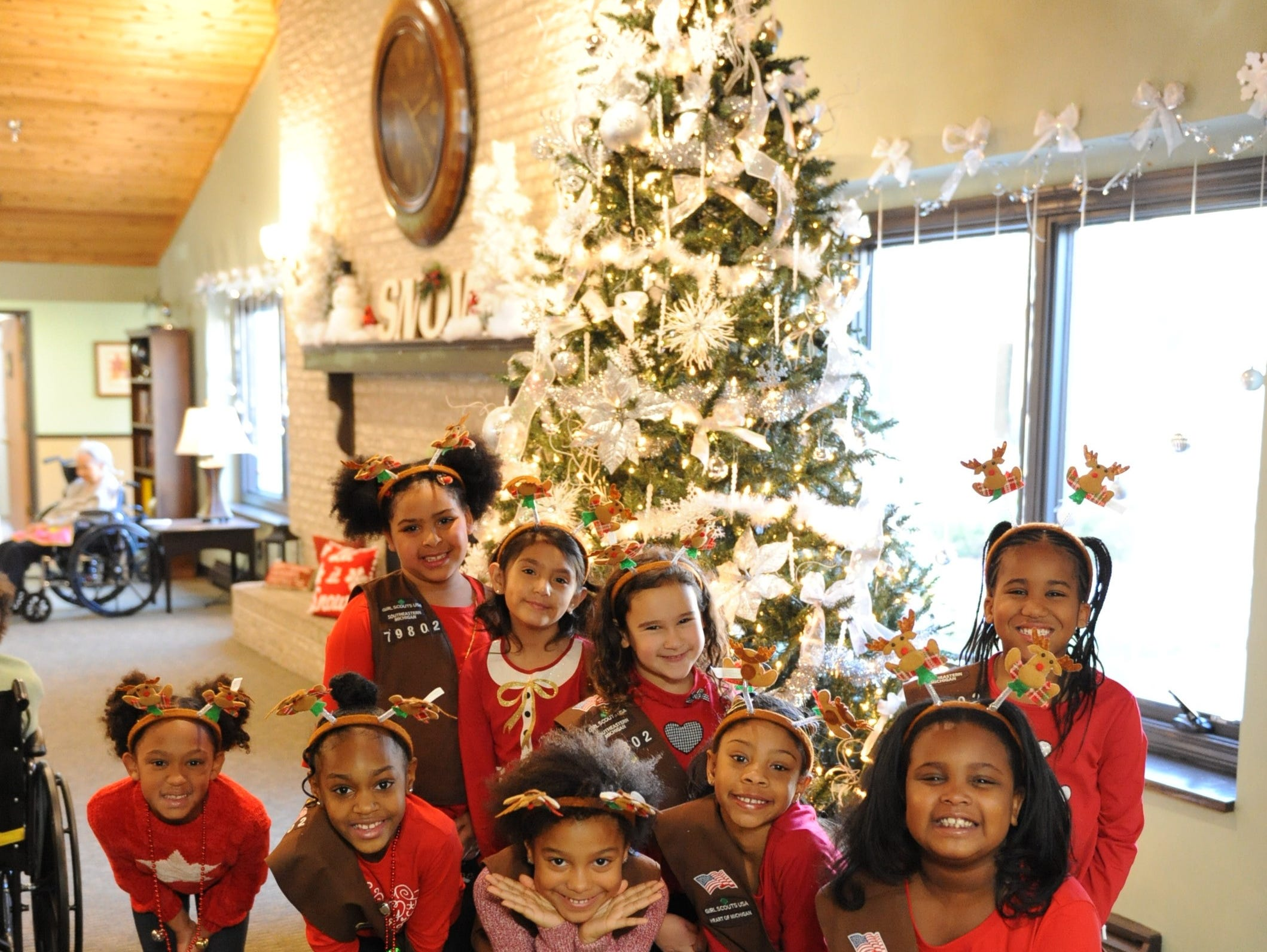 Woodcreek Brownie Troop #79802 poses for a photo after entertaining seniors at Courtyard Manor of Farmington Hills.