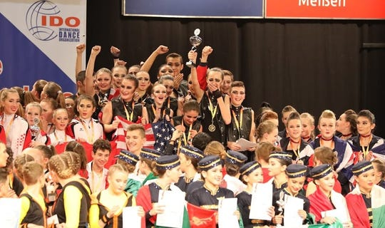 The United States team celebrates after winning the gold medal at the World Tap Dancing Championship in Riesa, Germany, Dec. 1.