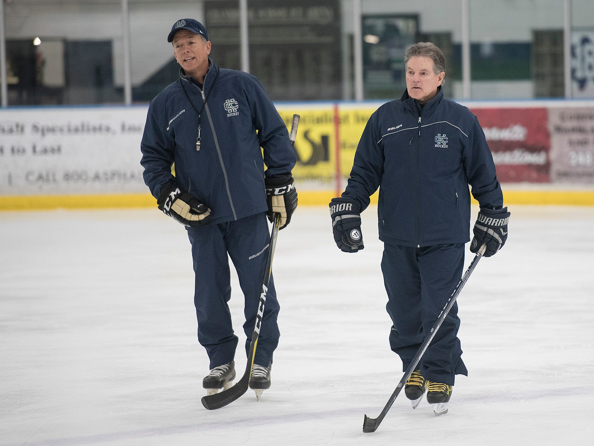 Coach Andy Weidenbach, at right, with assistant coach John LaFontaine at Wednesday afternoon practice.