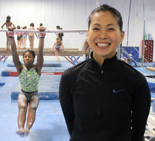 Cynthia Tan, who previously coached at Birmingham Groves, Troy and Rochester Adams,  is excited to lead the newly-formed Bloomfield Hills gymnastics squad.