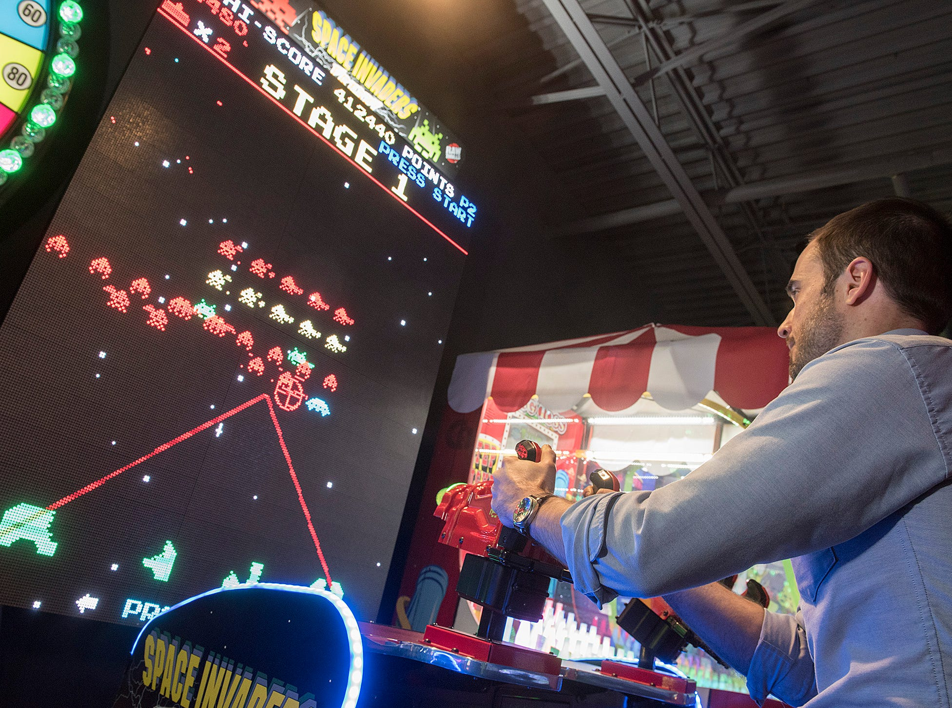Michael Shearer plays Space Invaders, his personal fave.