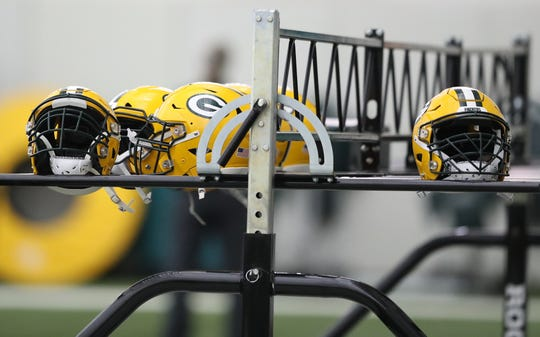 Helmets waiting for heads during practice Thursday, December 13, 2018 in the Don Hutson Center in Ashwaubenon, Wis.