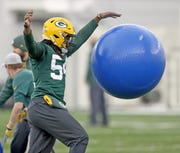Green Bay Packers linebacker James Crawford (54) with a training ball during practice Thursday, December 13, 2018 in the Don Hutson Center in Ashwaubenon, Wis.