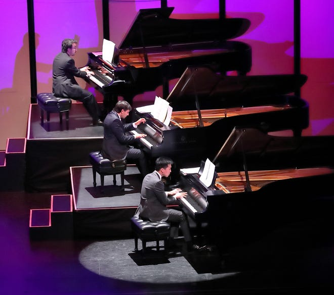 The Pianists from back to front Scott Cuellar, Vijay Venkatesh, and Evan Lin