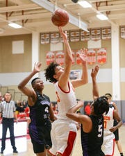 Palm Desert's Devin Lopez attempts to score against Shadow Hills.