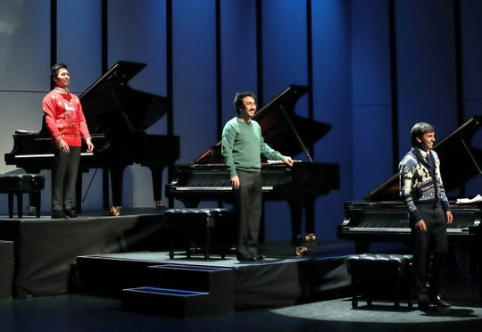 The pianists in their holiday sweaters.