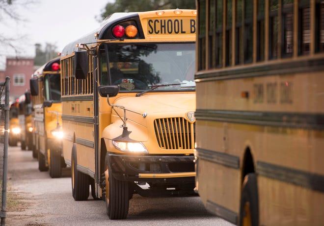 Escambia District Schools buses depart Pensacola High School in Pensacola on Thursday, December 13, 2018.