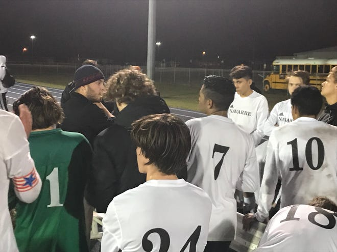 Navarre interim head coach James Baccarini (left, beanie) coaches his team after a 3-1 win over Booker T. Washington. Head coach Abdalla Elbaioumy and the Raiders are one of the area's top teams early in 2019.