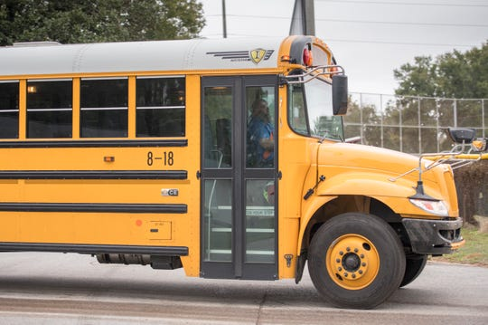 An Escambia District Schools bus arrives at Pensacola High School in Pensacola on Thursday, December 13, 2018.