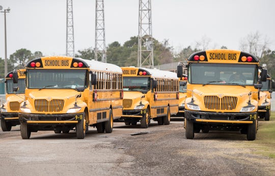 Escambia County School District buses await outside Pensacola High School for classes to be dismissed Dec. 13.
