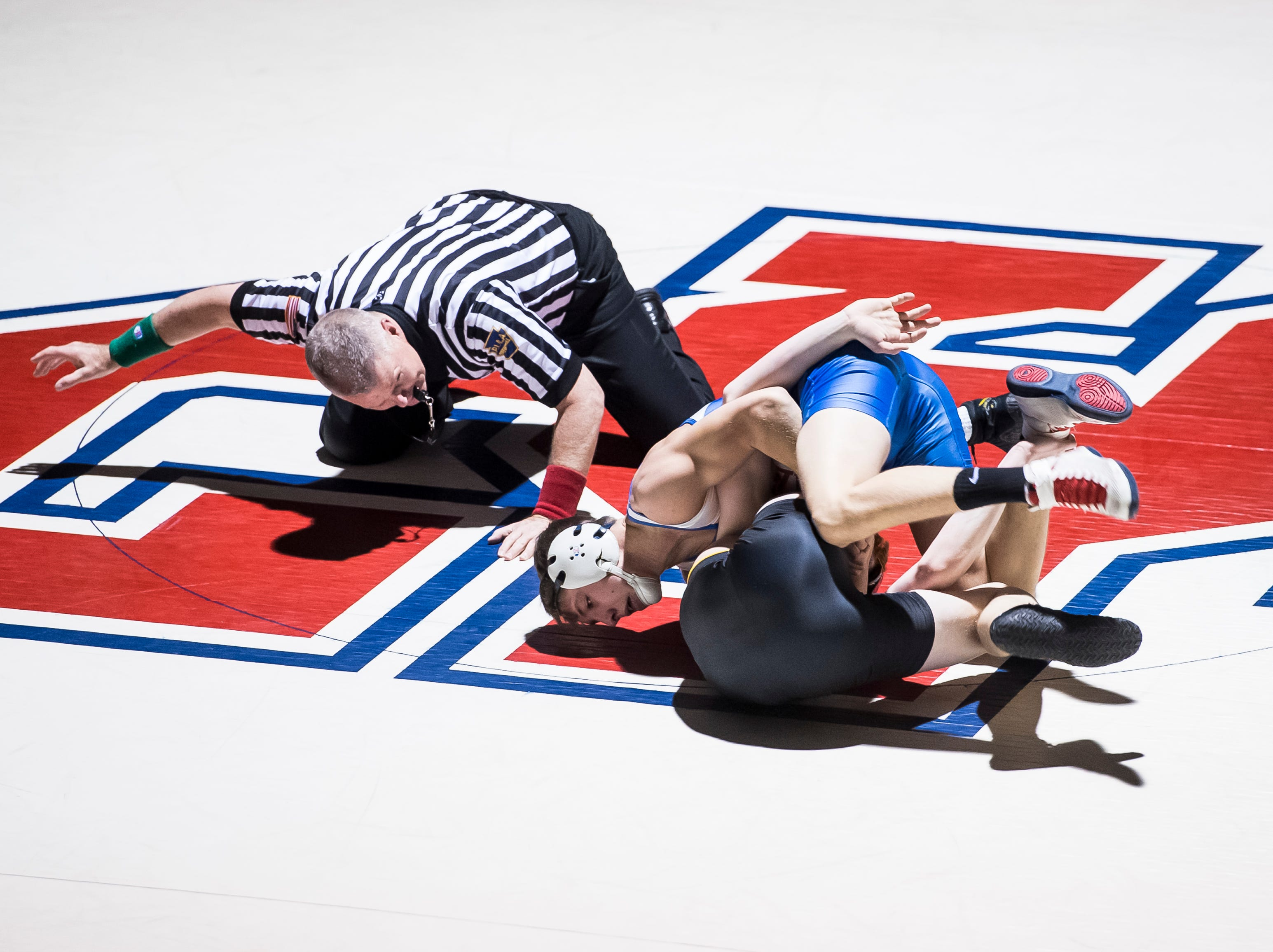 Spring Grove's Clay Baker (top) wrestles Red Lion's Ryan Fry in the 138-pound bout at Spring Grove High School on Wednesday, December 12, 2018. Baker won by a technical fall and the Rockets won, 68-9.