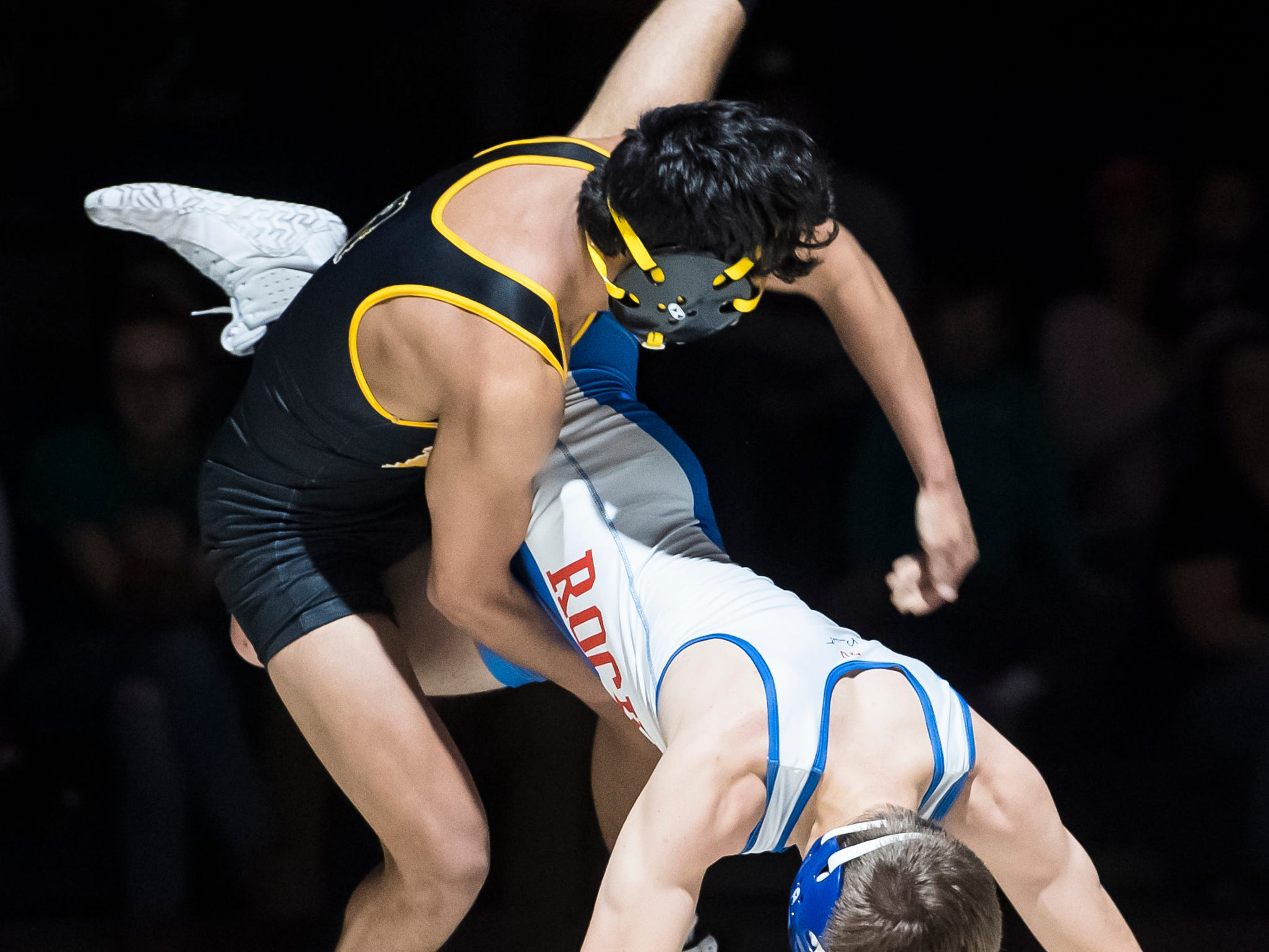 Spring Grove's Brayden Ross wrestles Red Lion's Caleb Strayer in the 126-pound bout at Spring Grove High School on Wednesday, December 12, 2018. The Rockets won the dual 68-9.