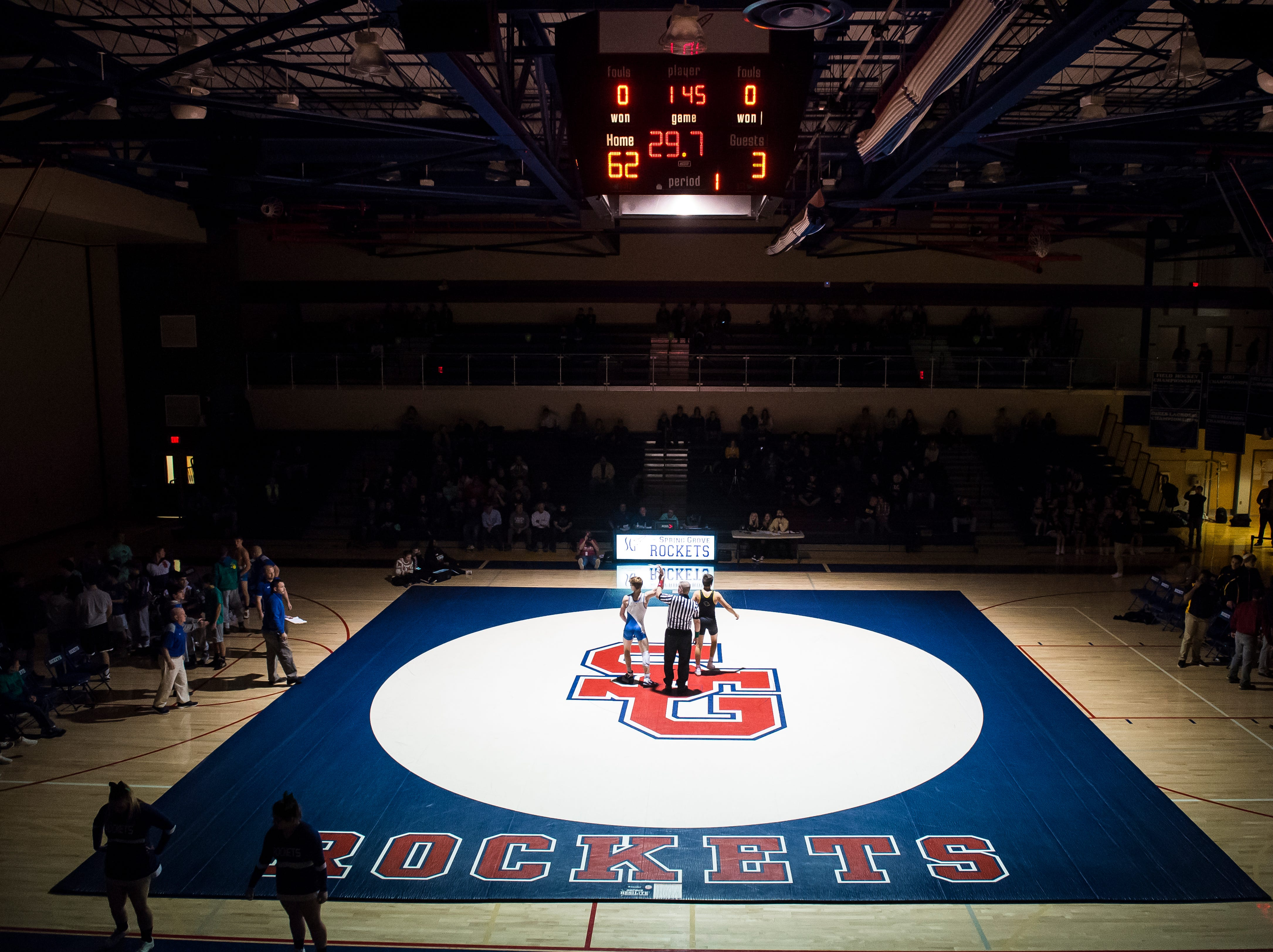 Spring Grove's Thomas Dressler gets his hands raised after defeating Red Lion's Kyle Daugherty in the 145-pound bout at Spring Grove High School on Wednesday, December 12, 2018. The Rockets won the dual 68-9.