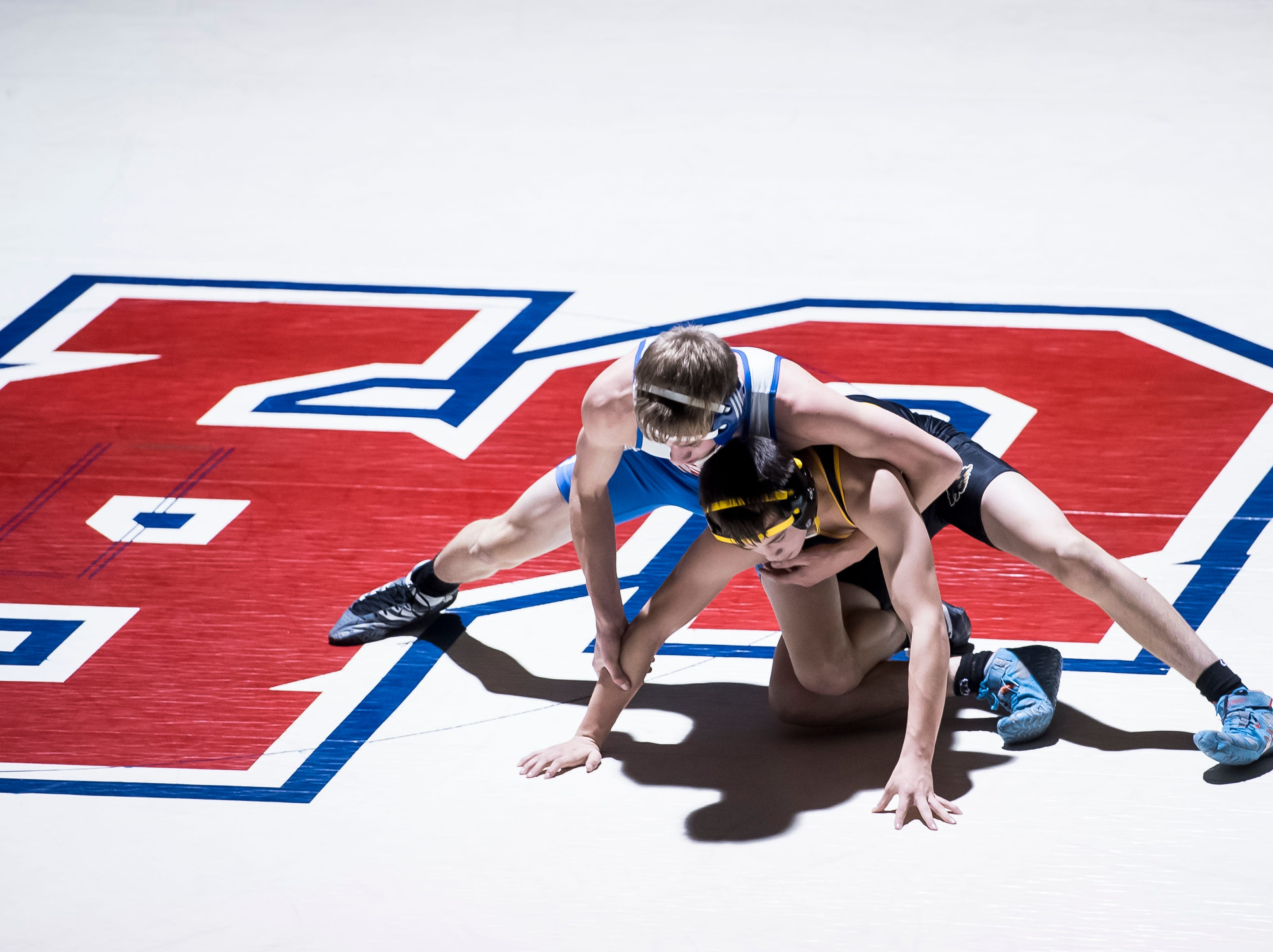 Spring Grove's William Smyser, top, wrestles Red Lion's Christian Dennison in the 132-pound bout at Spring Grove High School on Wednesday, December 12, 2018. The Rockets won the dual 68-9.