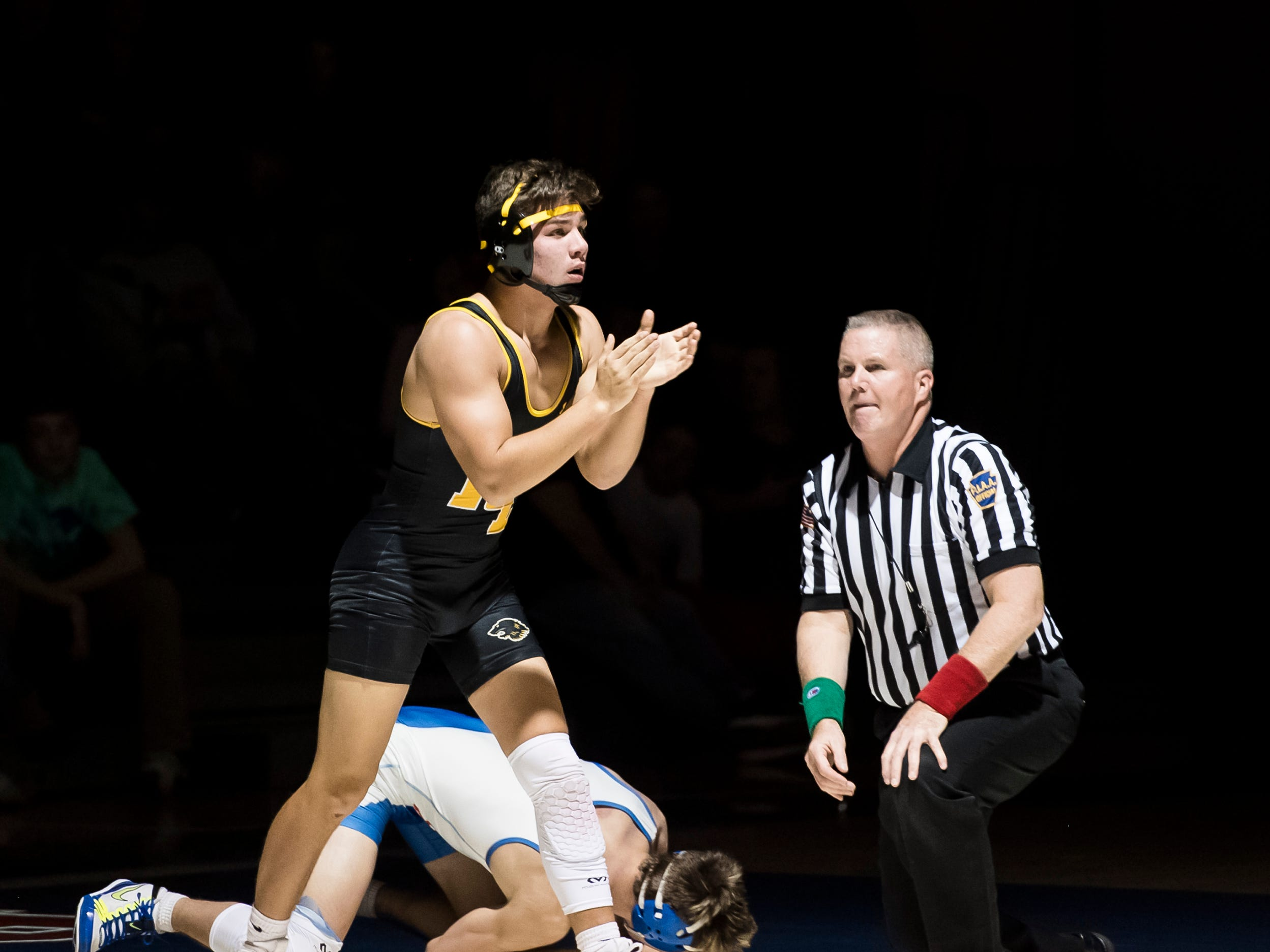 Red Lion's Cole Daugherty claps after defeating Spring Grove's Kahle Zumbrum in the 152-pound bout at Spring Grove High School on Wednesday, December 12, 2018. The Rockets won the dual 68-9.