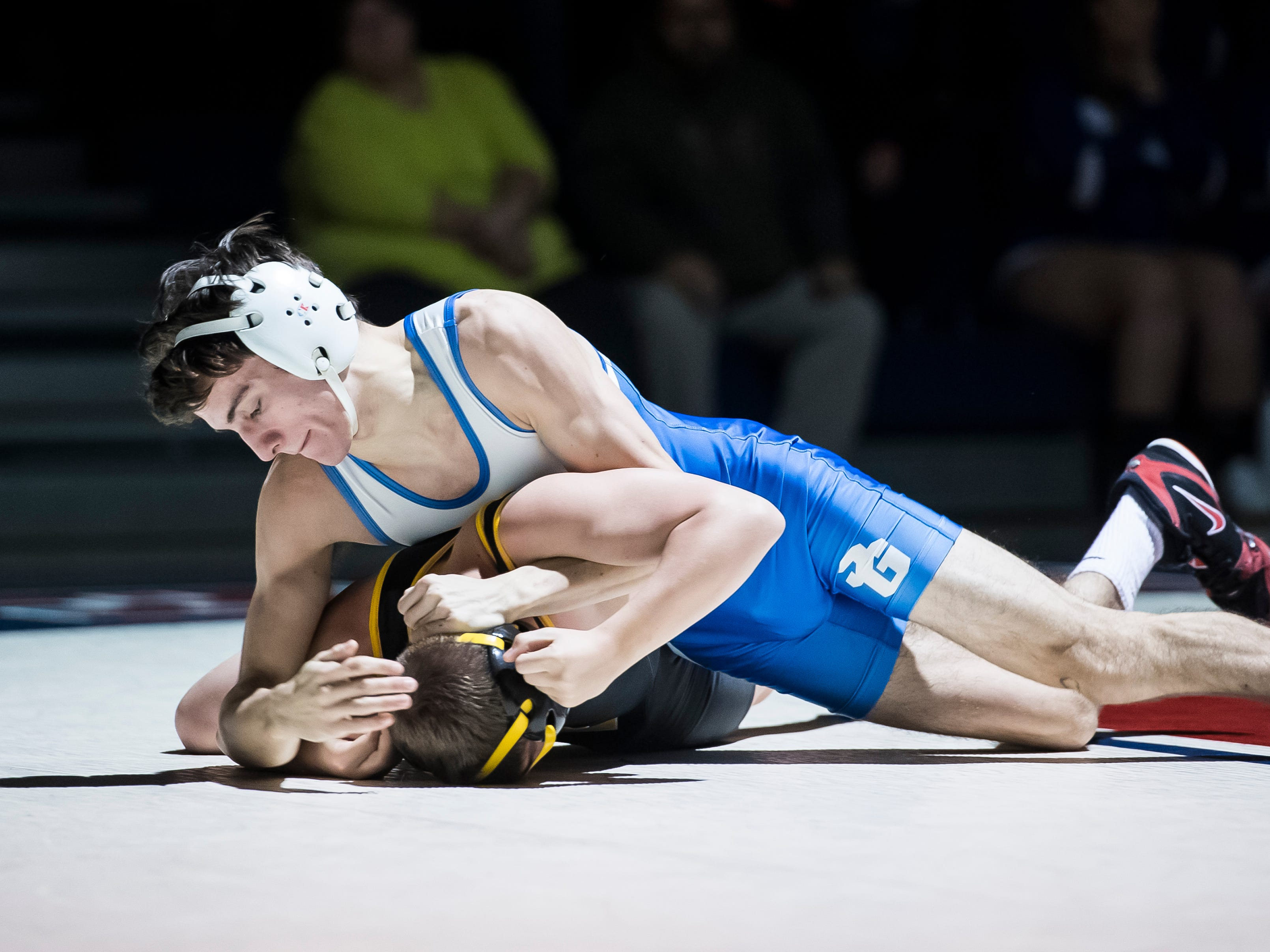 Spring Grove's CJ Styk, top, wrestles Red Lion's Dalton Boyer in the 120-pound bout at Spring Grove High School on Wednesday, December 12, 2018. The Rockets won the dual 68-9.
