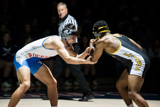 Spring Grove's Anthony Hinson, left, wrestles Red Lion's Stanley Dai in the 170-pound bout at Spring Grove High School on Wednesday, December 12, 2018. The Rockets won, 68-9.