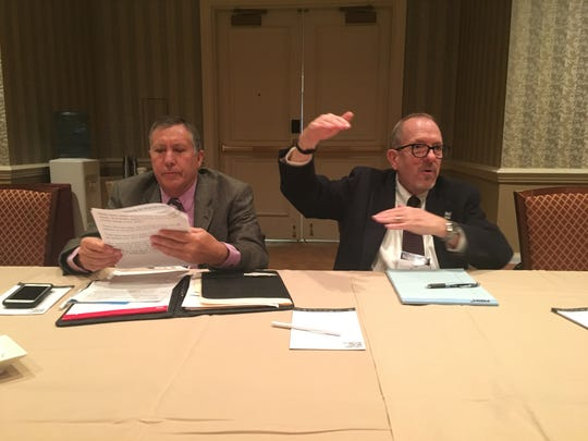 Tom Buschatzke (left), director of the Arizona Department of Water Resources, and Ted Cooke (right), general manager of the Central Arizona Project, speak with reporters at the annual Colorado River Water Users Association conference in Las Vegas on Thursday.