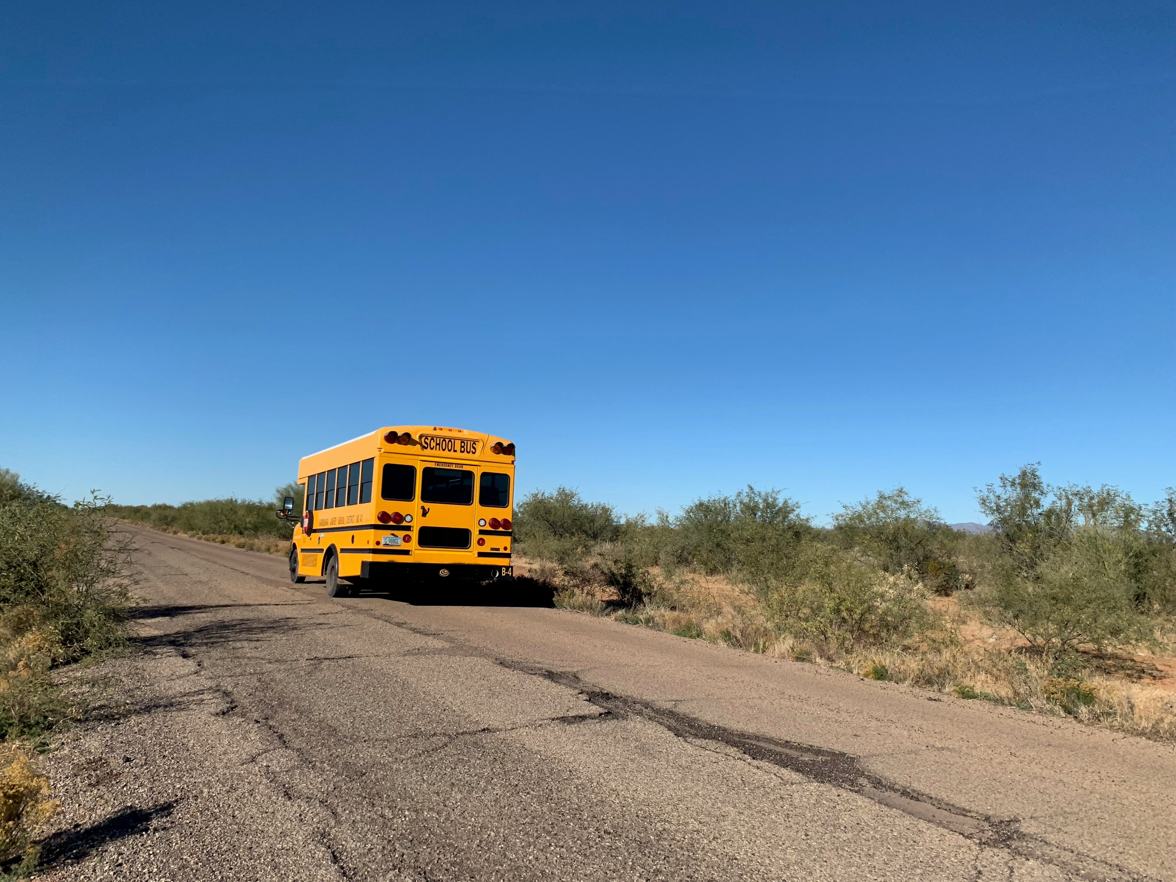 A school bus drives down a road to a village on the Tohono O'odham reservation in southern Arizona.
