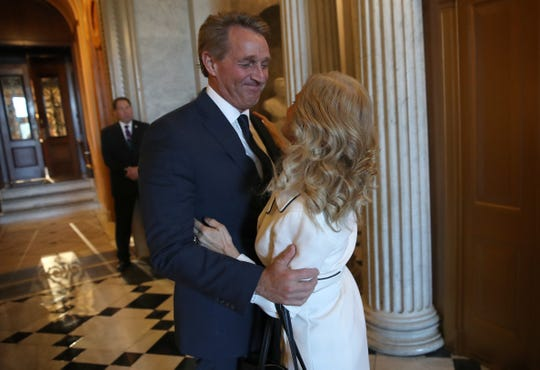 Sen. Jeff Flake (R-AZ) hugs his wife, Cheryl, after delivering his farewell speech on the floor of the U.S. Senate Dec. 13, 2018 in Washington, D.C.