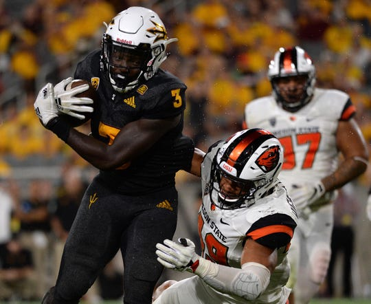 Arizona State Sun Devils running back Eno Benjamin (3) breaks the tackle of Oregon State Beavers linebacker Andrzej Hughes-Murray (49) en route to a touchdown during the second half at Sun Devil Stadium. Joe Camporeale-USA TODAY Sports