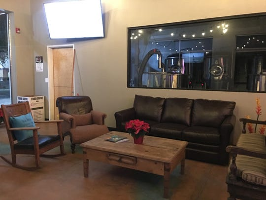 A couch and chairs give patrons a brewing-room view at Desert Monks Brewing Co. in Gilbert.