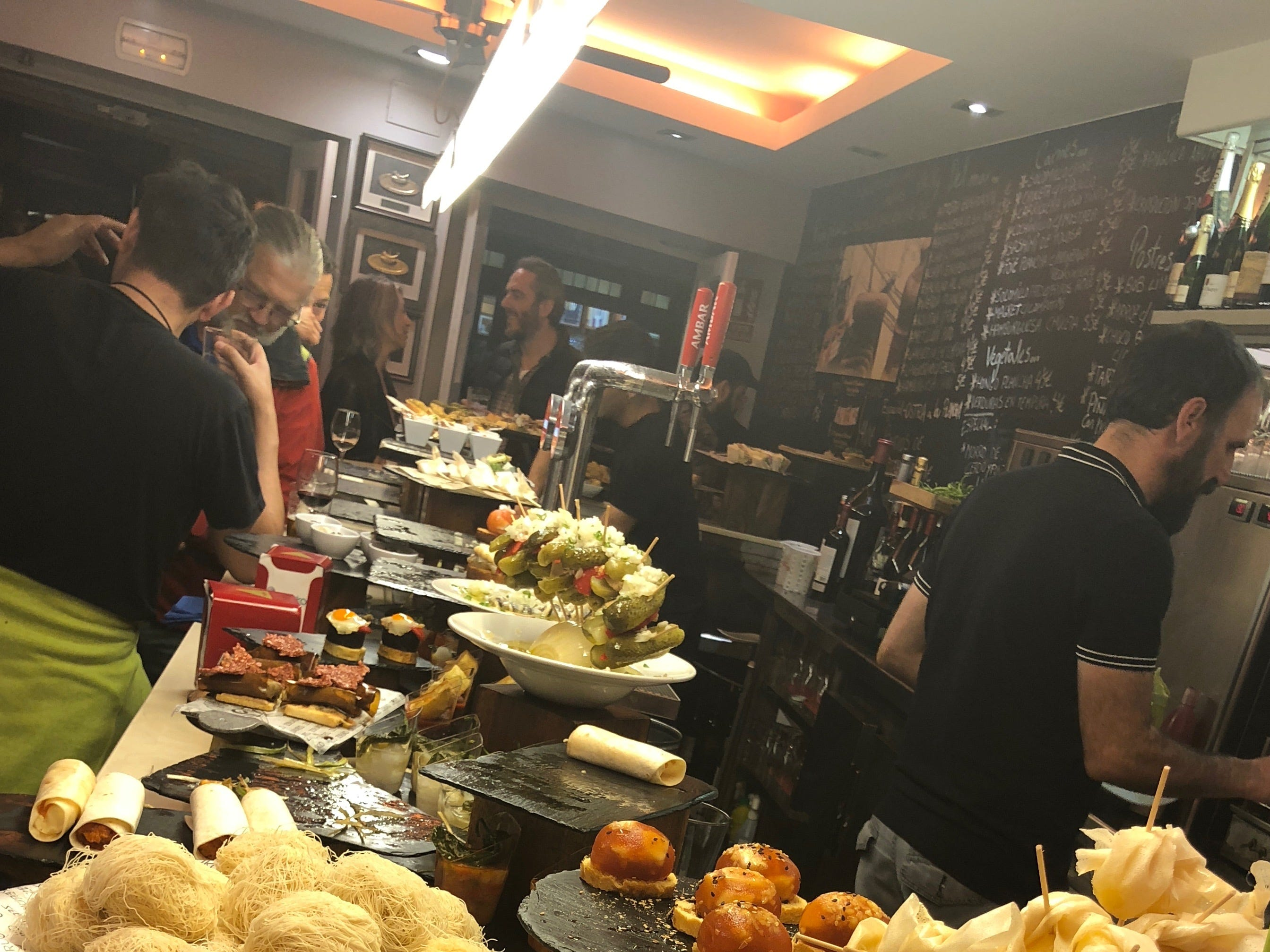 A collection of inventive pintxos at Bar Zeruko in the Old Town section of San Sebastian, Spain. A pintxos crawl is a nightly occurrence here for residents and tourists alike