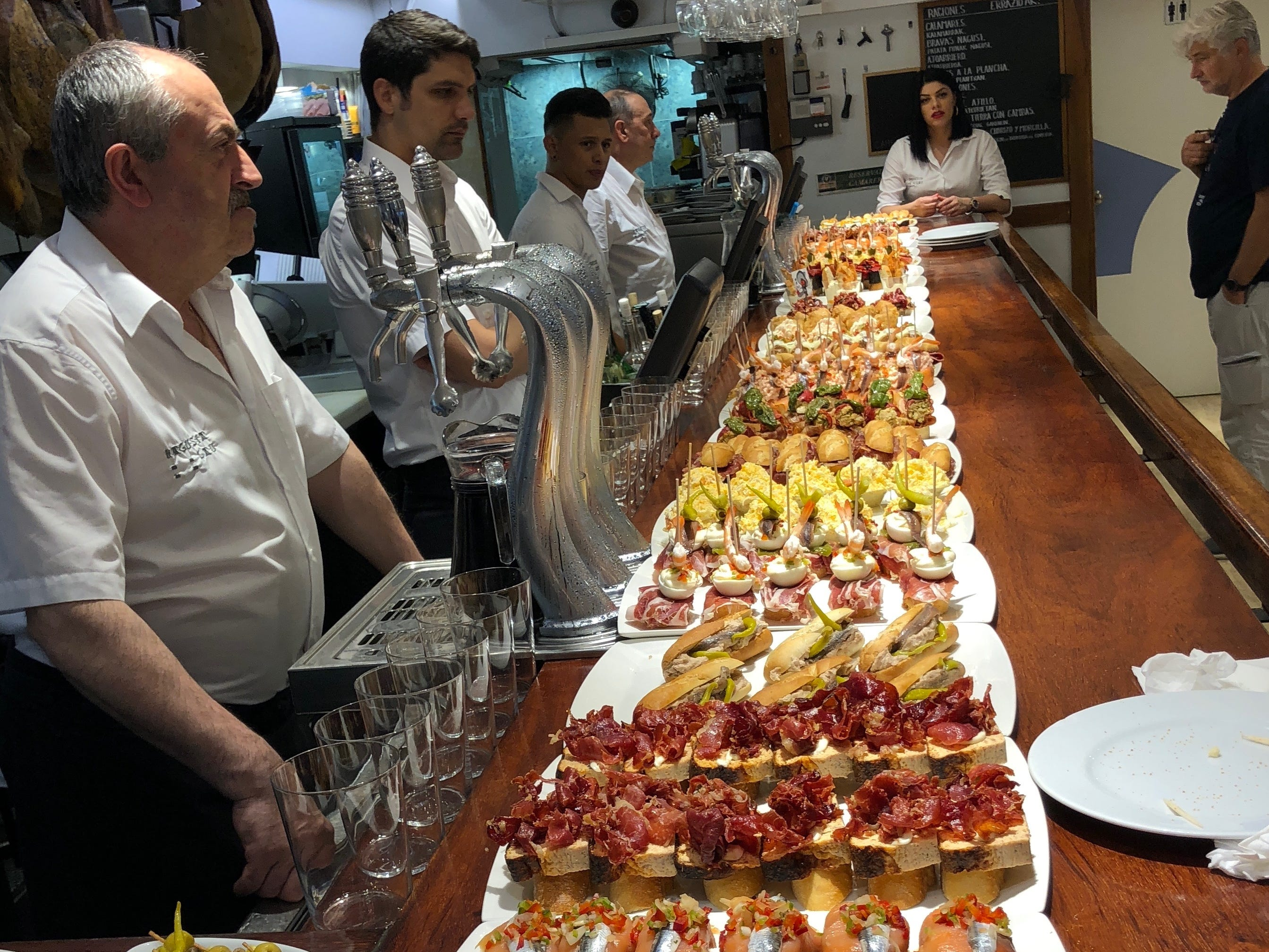 A collection of inventive pintxos at a tavern in the Old Town section of San Sebastian, Spain. A pintxos crawl is a nightly occurrence here for residents and tourists alike