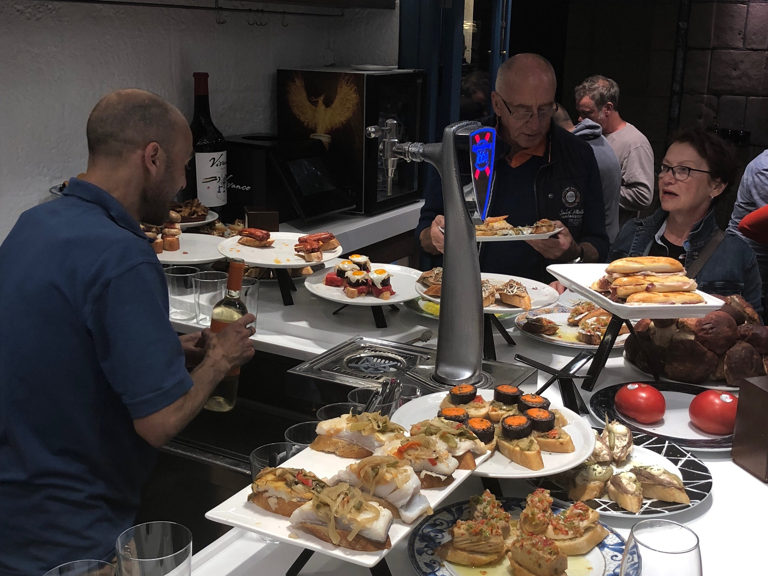 A collection of inventive pintxos in the Old Town section of San Sebastian, Spain. A pintxos crawl is a nightly occurrence here for residents and tourists alike