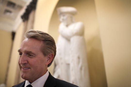 "Sen. Jeff Flake (R-AZ) answers questions from a reporter after delivering his farewell speech on the floor of the U.S. Senate Dec. 13, 2018 in Washington, D.C. During his speech Flake said, ""Let us recognize from this place here today that the shadow of tyranny is once again enveloping parts of the globe. And let us recognize as authoritarianism reasserts itself in country after country, that we are by no means immune."""