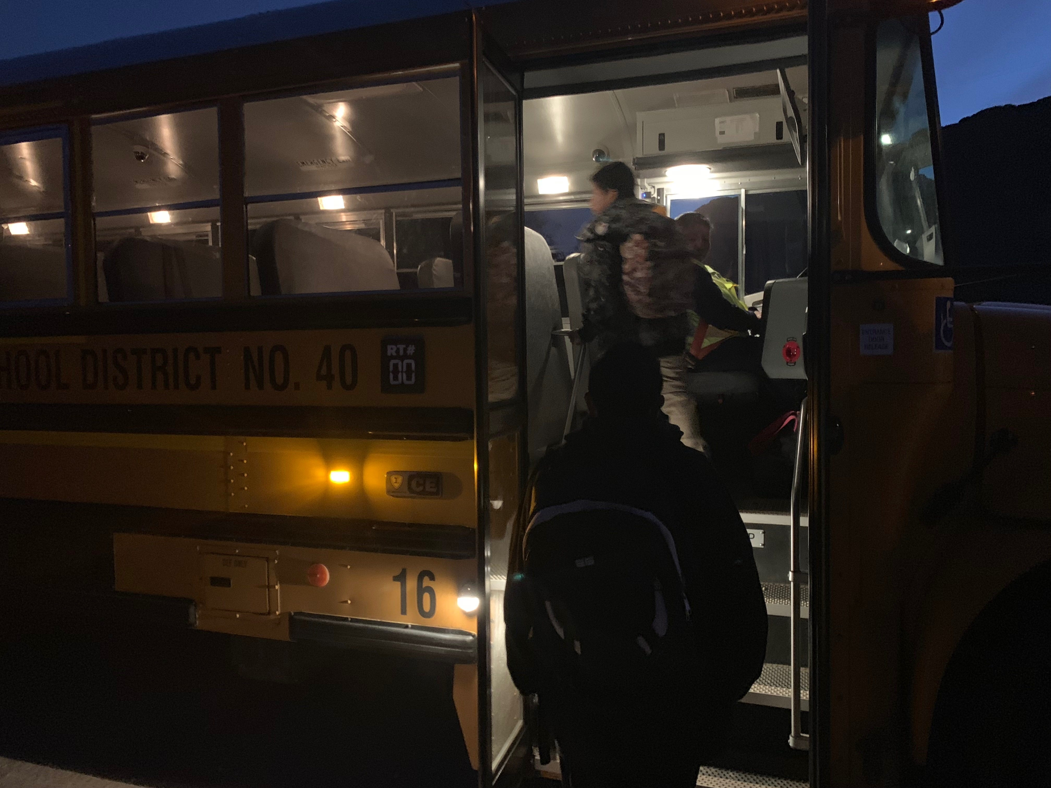 Students in the Baboquivari Unified School District board their bus early in the morning to head to school.