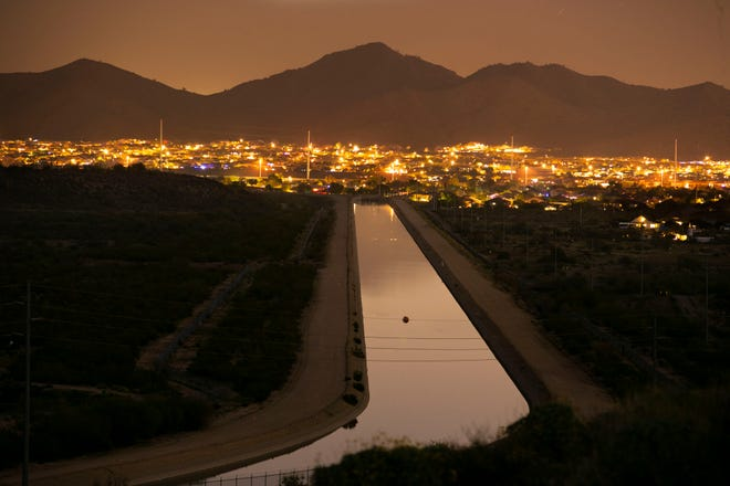 The CAP Canal heads towards a neighborhood in Phoenix as seen from the Deem Hills Recreation Area on December 12, 2018.