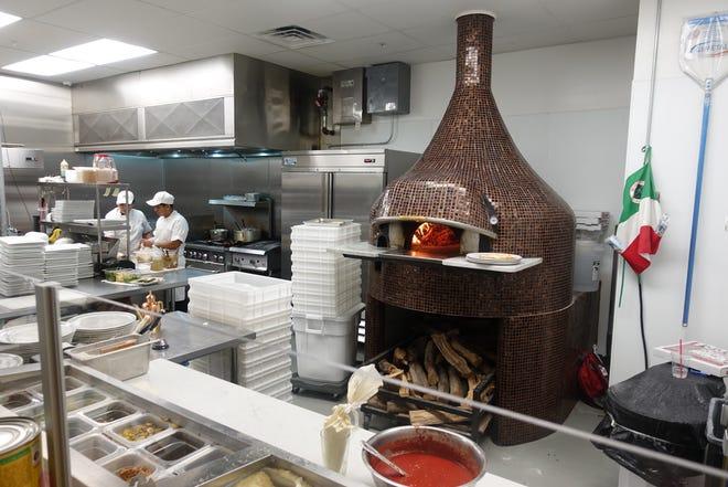 The kitchen and pizza oven at Mimi Forno Italiano in Laveen Village.