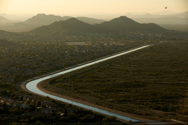 The CAP Canal winds through a neighborhood on one side and the desert on the other in Phoenix as seen from the Deem Hills Recreation Area on Dec. 12, 2018.