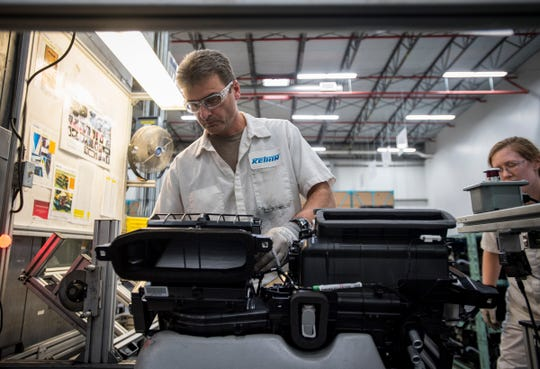 Paul Vandeberghe inspects an automotive HVAC assembly at Keihin Michigan Manufacturing LLC in Capac in this 2018 file photo.
